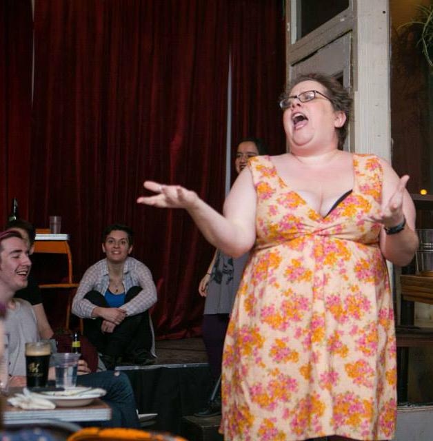 Founder Cameryn Moore hosting a Smut Slam
